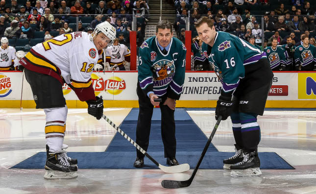 (L to R): Chicago Wolves Captain Phil Cannone, 1996-97 Moose Captain Randy Gilhen and current Moose Captain John Albert